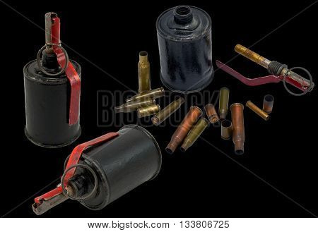 A grenade and bullet on black background