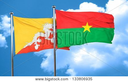 Bhutan flag with Burkina Faso flag, 3D rendering