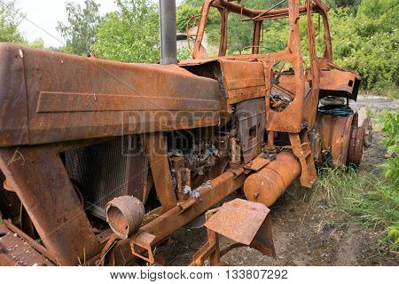 Old rusty vintage tractor in a farm