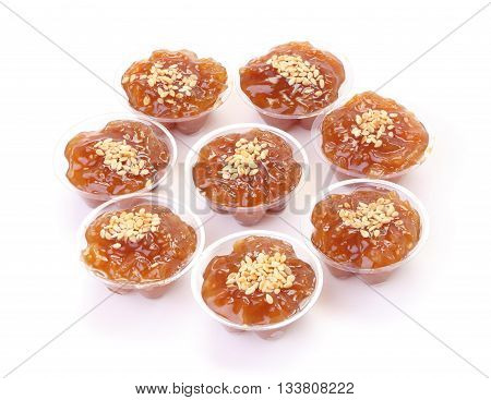 Circle of group brown flavored sweet translucent gelatinous rice.