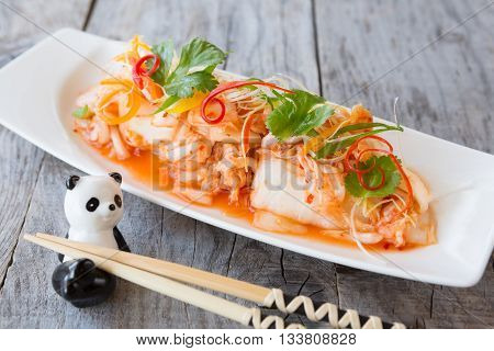 Marinated korean kimchi cabbage snack on a wooden table