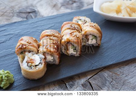 Traditional japanese rolls with smoked eel and rice