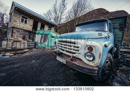 Gergeti Georgia - April 25 2015. Old rusty ZIL-133 in small Gergeti village in Mtskheta-Mtianeti region