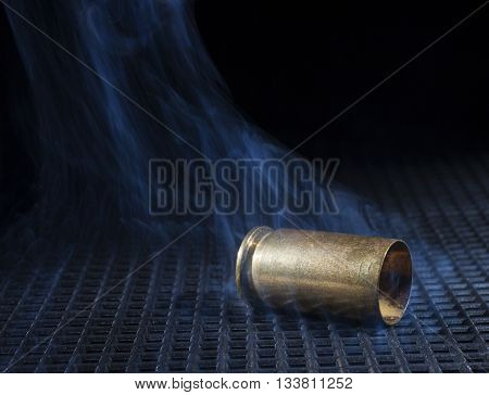 Empty brass from a semi automatic handgun with smoke