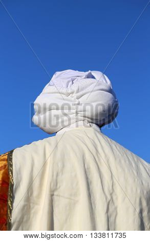 Arab Man With White Turban And Sky In Background