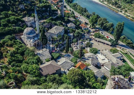 Pocitelj Bosnia and Herzegovina - August 26 2015. Aerial view from 14th century fortress on Pocitelj village in Capljina municipality with Mosque of Hajji Alija