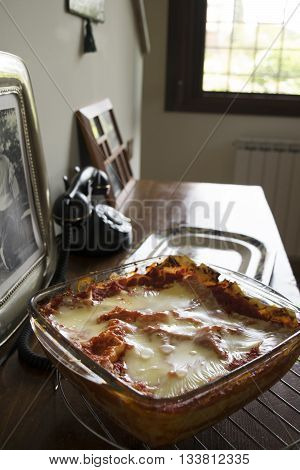 stuffed lasagne with mozzarella and tomato sauce in a glass bowl
