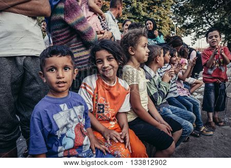 Belgrade Serbia - August 29 2015. Children in a makeshift refugee camp in one of the parks in Belgrade