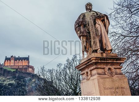 Edinburgh UK - January 20 2015. Monument of Thomas Guthrie in Edinburgh. View with Edinburgh Castle