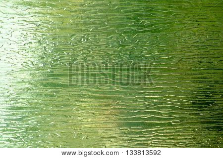 The light through the green glass with abstract pattern