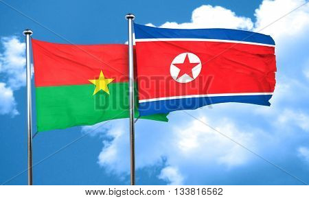 Burkina Faso flag with North Korea flag, 3D rendering