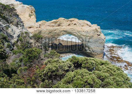 arch carved by the sea via erosion of the limestone coast