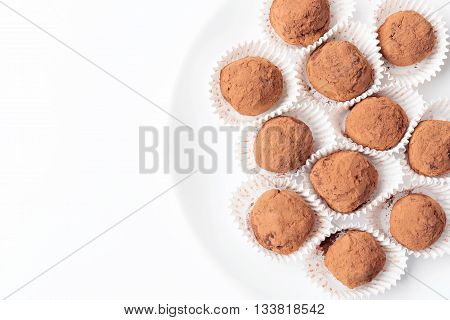 homemade chocolate truffles with cocoa powder in paper cups
