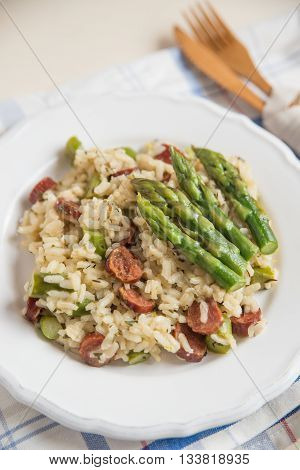 Home made Asparagus Risotto with salami on a plate
