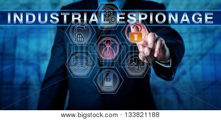 Cyber agent touching INDUSTRIAL ESPIONAGE on an interactive control screen. Computer security and information technology concept for cyberwarfare corporate crime piracy and trade secret theft.