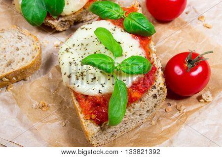 Italian Bruschetta With Cherry Tomatoes, Mozzarella & Fresh Basil.
