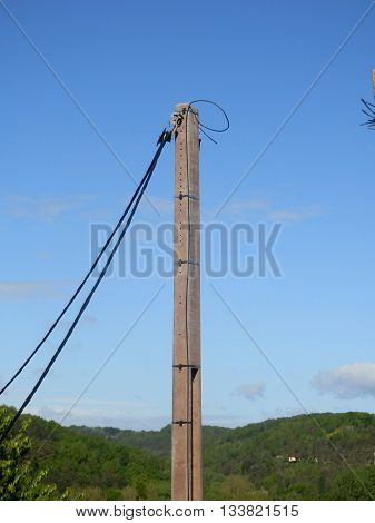 Cable being winched through a pulley at the top of an electricity pylon