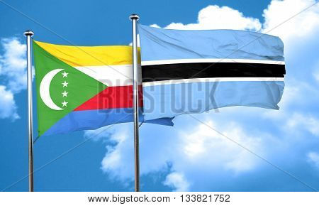 Comoros flag with Botswana flag, 3D rendering