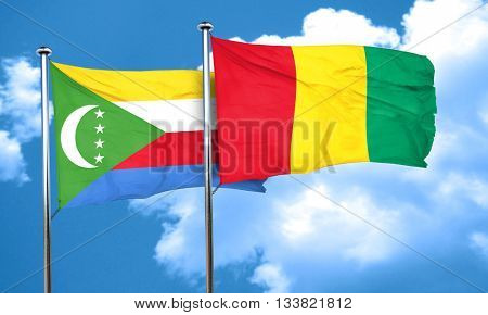 Comoros flag with Guinea flag, 3D rendering