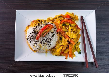 Thai dish with chicken in green curry souce and rice