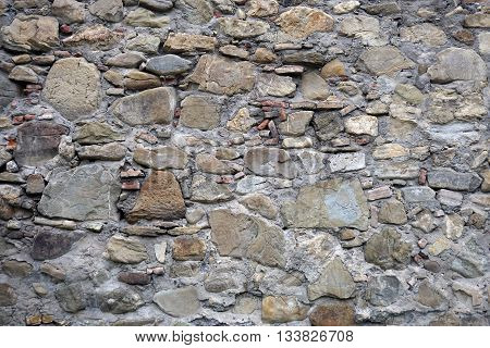 texture, background of stones of different sizes and colors of the walls of houses in Georgia