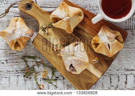 Freshly baked homemade scones on a cutting board on a table. Homemade pastries . Close-up. Top view