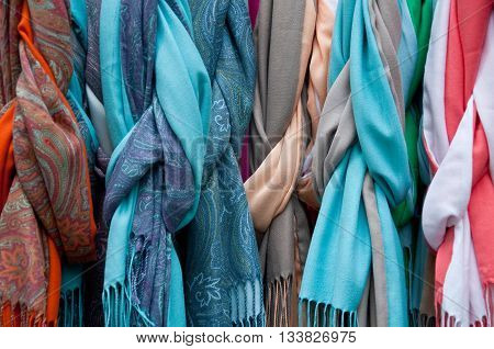 group of beautiful colored scarves in cotton and wool