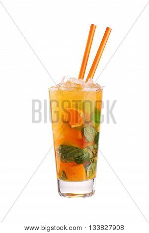 Glass of orange mojito with mint, orange wedges and straws isolated on white