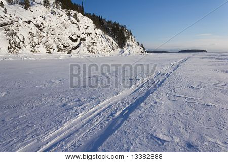 Trace of the snowmobile on the ice