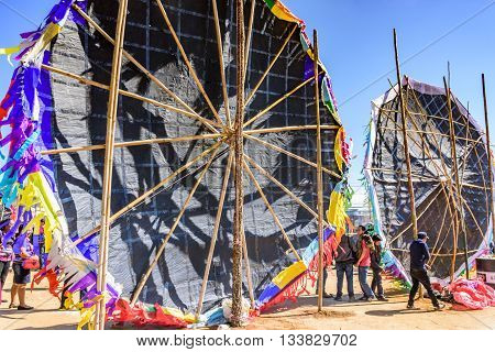Sumpango Guatemala - November 1 2015: Rear view of standing giant kites shows bamboo framework at giant kite festival on All Saints' Day honoring spirits of dead.