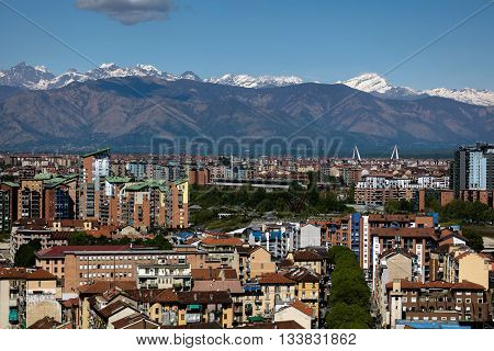TURIN ITALY - APRIL 25 2016: Panorama of the Turin Italy with the snow covered Alps in the background viewed from the Turin Eye air balloon.