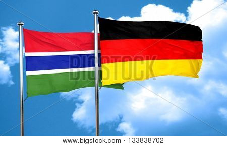 Gambia flag with Germany flag, 3D rendering