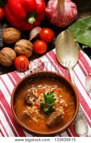 Kharcho soup. Thick beef soup with rice tomatoes carrots peppers walnuts and spices. A traditional dish of Georgian cuisine