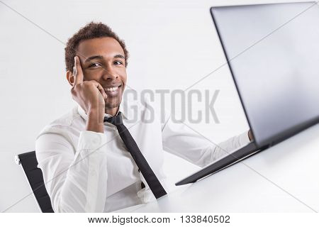 Cheerful Guy Using Laptop