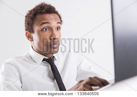 Surprised Guy Using Laptop
