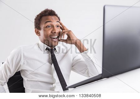 Happy Surprised Businessman With Laptop