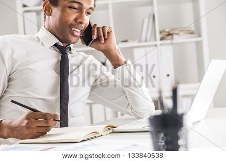 Young Black Man In Office