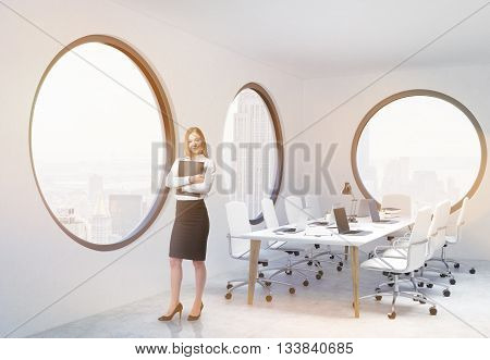 Young businesswoman with document in hand standing in modern conference room interior with round windows and New York city view. 3D Rendering