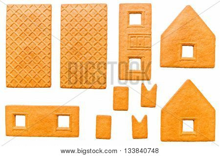 Baked Parts For Build Of Christmas Gingerbread House On A White Background