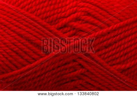 red woolen thread is wound beautiful closeup