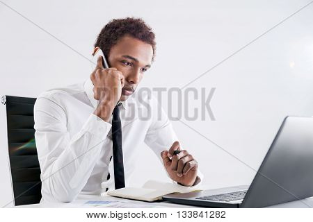 Concentrated Black Businessman On Phone
