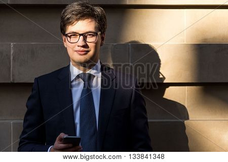 Businessman With Phone Outside
