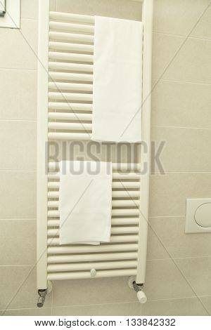 The towel dryer with the white towels