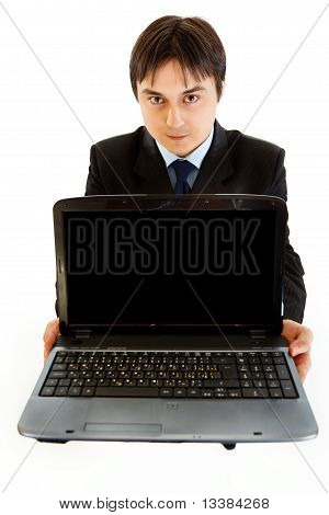 Smiling businessman holding laptops blank screen isolated on white