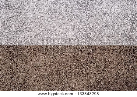Half colored texture plaster wall exterior gray and biege