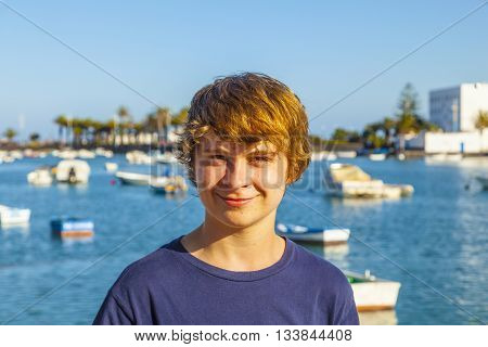 Handsome Happy Smiling Boy With The Famous Charco De San Gines In Lanzarote In The Background