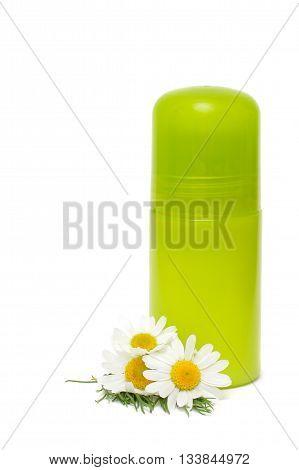 Green jar of a deodorant and flower isolated on a white background