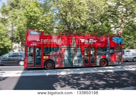 London, Westminster, United Kingdom, 06 June 2016: Tourist attraction, open double decker bus makes a city tours for tourists in London