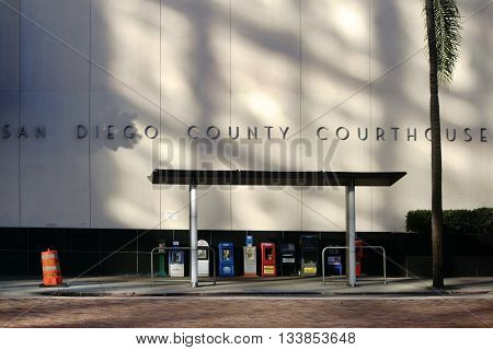 SAN DIEGO, UNITED STATES - DECEMBER 25: A bus stop with journal articles is on the facade of the courthouse on December 25, 2015 in San Diego.
