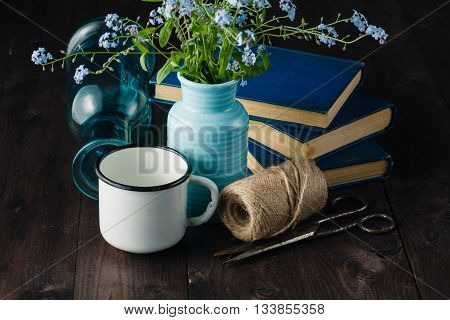 Vintage Books On Table With Forget Me Not Flowers